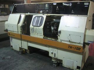 Wasino TH-102 CNC LATHE, Fanuc 0T,Two Spindles, Two Turrets
